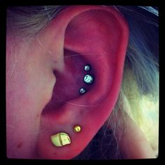 triple helix piercing | Triple Helix Piercing   That, my friend, is called a conch piercing. In other words... OUCH.