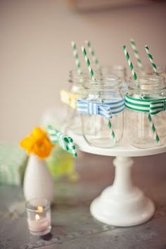 Unique way to use Glass Jars at your wedding... Wrap a ribbon around and add a matching straw for signature cocktails!