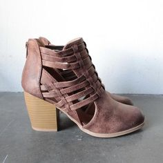 These ankle booties feature an oil distressed upper, strappy design, with open sides, back zip closure , set on a stacked heel and lightly padded insole for you