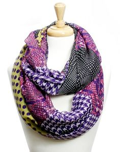 This and That Infinity Scarf, $16 w FREE shipping. A little bit of this, a little bit of that-- from houndstooth to polka dots, this fun infinity scarf add the perfect purple pop to your outfit! SHOP NOW: http://shopbrandys.com/collections/accessories/products/this-and-that-infinity-scarf