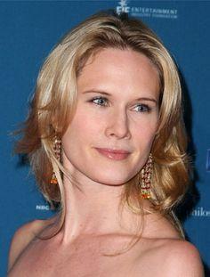 Stephanie March wearing Donna Distefano 18k ruby & Sapphire earrings.
