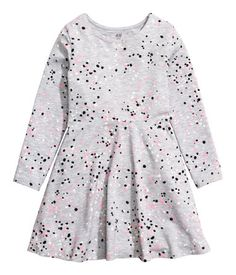 Light gray/dotted. CONSCIOUS. Dress in soft jersey made from organic cotton. Long sleeves, seam at waist, and flared skirt.