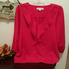 HP 2/17 @whatsleft❤LOFT ❤ Red ruffle collar blouse HOST PICK 2/17 Wardrobe Refresh. ❤❤❤❤ Lovely red double v ruffled collar blouse.  Comfortable & light weight!  Elastic sleeves & bottom of blouse for stretch.   Says Small, but could also fit a medium!  100% polyester  In EUC! LOFT Tops Blouses