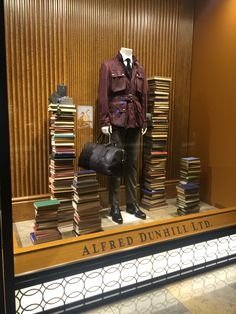 "ALFRED DUNHILL LTD., The Landmark, Hong Kong, China, ""The books we read answer questions we didn't even know existed"", photo by Lincoln Keung, pinned by Ton van der Veer"