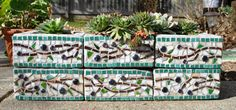 great idea to mosaic cinderblocks for planters.