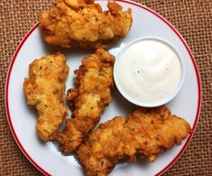 Learn how to make the best damn buttermilk chicken tenders ever. Golden, delicious flour based breading crisps around buttermilk marinated chicken strips.