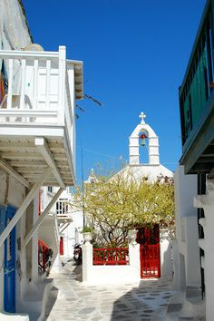 GREECE CHANNEL | mykonos-they white wash everything and then paint doors, window sills and shutters bright colors.