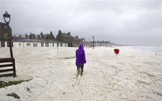 High winds sweep North Sea foam onto Footdee, Aberdeen, Scotland