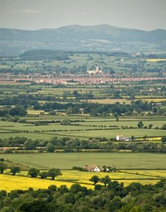 Tewkesbury Abbey and the Malverns from Cleeve Hill, Cheltenham.