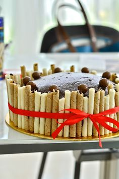 Clever: use wafers to surround the cake for a clean/easy design
