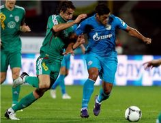Alexander Demianchuk (RUSSIA) Zenit St. Petersburg's new signing Hulk (R) challenges Terek Groznyi's Jose Mauricio during their Russian Premier League soccer match at the Petrovsky Stadium in St. Petersburg, September 14, 2012. Big-spending Zenit St Petersburg have splashed a record 80 million euros on Brazil striker Hulk and Belgium midfielder Axel Witsel, signing each to a five-year contract, the Russian champions said on September 3.