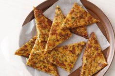 Enjoy these cheesey cauliflower flat breads warm from the oven or serve them cold as a lunch box snack.