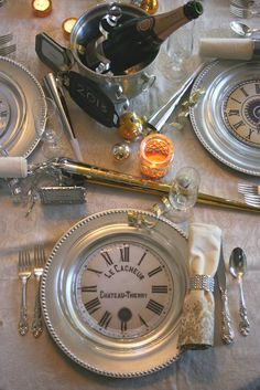 A new year's eve dinner love the paper clock face under clear glass plates