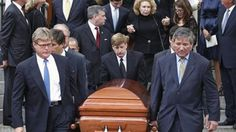 Kara Kennedy's casket is carried from the church by her two brothers, Teddy Jr. and Patrick, and other cousins. Behind the casket is her mother Joan Kennedy held onto by Kara's son Max and his wife.