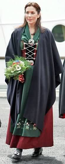 Crown Princess Mary of Denmark shown here in her own National Costume.  Humphries weaving wove a similar broadloom chequered apron cloth in pure silk in black, with red and pink detail. This was for restoration of the National Costume of the Queen of Denmark. www.humphriesweaving.co.uk