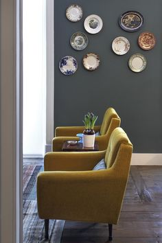 Fancy Yellow Chairs at Apartment Saldanha Living Room that Decorated Ceramic Plates Adhered on the Wall, Lisbon Apartment, Muebles Living, Vintage Plates, Living Room Grey, Living Furniture, Color Azul, Colour Combo, Plates On Wall, Plate Wall
