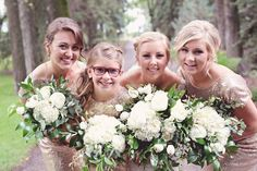 Gorgeous bridal party! Lush bridal bouquets of hydrangea, patience garden roses, lisianthus, tulips and rich assorted foliage.