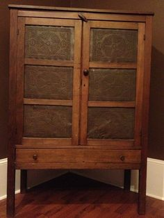 gorgeous Tennessee pie safe.  I like the star pattern in the tin panels and the worn wood.