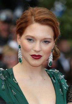 French actress Lea Seydoux in emerald and diamond earrings by Chopard.