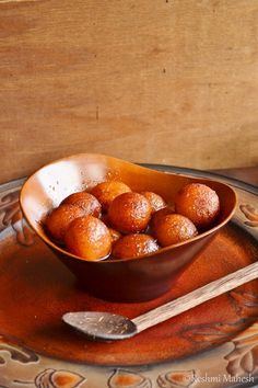 Gulab jamun, soft balls made of milk powder and then soaked in sugar syrup.