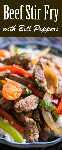 Quick stir-fried beef strips with sliced onions and red and green bell ...