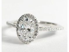 Oval Halo Diamond Engagement Ring. Absolutely freaking gorgeous. So unique, not many women have oval engagement rings anymore!! #APBling || Aisle Perfect