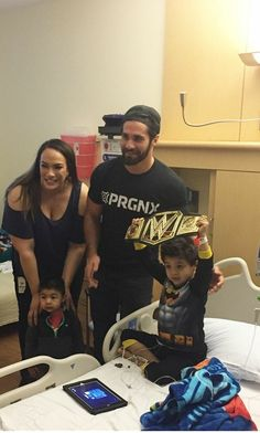 SETH ROLLINS and NIA JAX visiting kids in the  hospital.