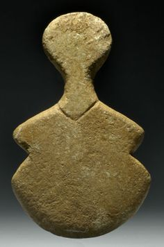 ANATOLIAN MARBLE VIOLIN IDOL OF THE KUSURA TYPE  With 'collar.'  Bronze Age II, 2700-2400 BC