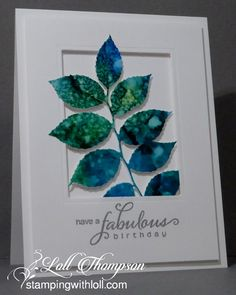 Alcohol ink glossy paper die cut leaf shape on greeting card.