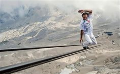 """""""Freddy Nock has just climbed Germany's highest mountain by tightrope walking up it's 1,000-meter-long cable car cable, which took an hour and 20 minutes."""""""
