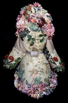 A selection of the costumes and smaller props handmade by British artist Kirsty Mitchell for her photographic collection the 'Wonderland' series 2009 - 2014