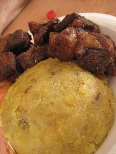 Mofongo con carne frita (mashed seasoned plantains and fried pork or chicken) plus descriptions of a huge number Puerto Rican dishes Puerto Rican Dishes, Puerto Rican Cuisine, Puerto Rican Recipes, Mexican Food Recipes, Puerto Rican Mofongo Recipe, Carne Frita Puerto Rico Recipe, Easy Mofongo Recipe, Sofrito Recipe, Comida Boricua