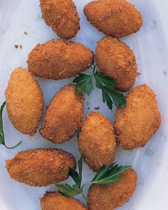 Croquettes with Serrano Ham and Manchego Cheese. Serve these bite-size croquettes warm, garnished with fresh parsley.