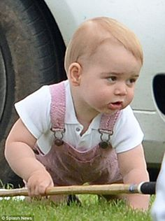 Dressed in dungarees and a white polo shirt, the Prince looked adorable on the family day out