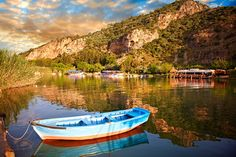 Ferry row boat on the Dalyan Delta River looking towards boats & fish restaurant. Mediterranean coast Turkey