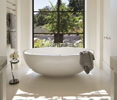 For these homeowners, as well as their architect and interior designer, reimagining a guesthouse became a years-long marathon with an indoor pool as a prize. Vintage Bathrooms, Modern Bathroom, Industrial Bathroom, Luxury Interior Design, Interior Decorating, Modern Mansion, Minimalist Architecture, Bathroom Styling, Beautiful Bathrooms