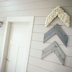 "This rustic arrow set is the perfect addition to any wall in your home. The reclaimed pallet wood is stained a steel gray color. Covered in natural white sola wood flowers. | Don't forget! Use coupon code ""SHARKTANK"" for 25% off - this code expires tomorrow!"