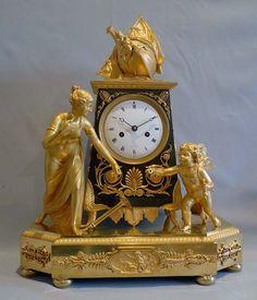 Antique French Empire ormolu mantel clock of Hope overcoming despair. - Gavin Douglas Antiques