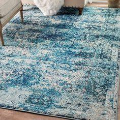Akshay Vintage Shuler Ocean Blue Area Rug