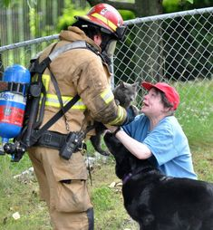 A kind-hearted firefighter goes out of his way to reunite a woman with her rescued cat.
