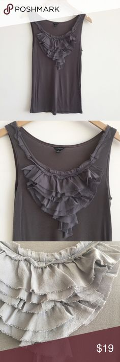 """Ann Taylor Steel Blue Gray Ruffle Front Tank Beautiful tank top from Ann Taylor features a finely ribbed Tencel body and tiers of silk ruffles at neckline. Great for layering!  • size S • 26"""" length from shoulder  • color: gray/blue • 100% tencel exclusive of trim • gently worn a couple of times and in good condition; minor signs of wear Ann Taylor Tops Tank Tops"""