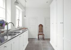pure white handpainted on ash, white knobs in porcelain from France Stainless Steel Counters, Stainless Sink, Flagstone Flooring, Floor Colors, Large Homes, Kitchen Cupboards, Kitchen Flooring, Home Kitchens, Laundry Room