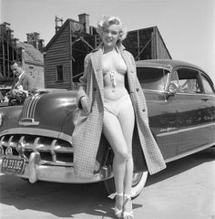 """Marilyn Monroe Poses with a Pontiac """"Chieftain"""", 1951"""