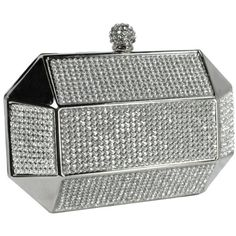 """Price: $31.99   Divine Rhinestone Studded Spherical Top Clasp Rectangle Hard Case Minaudiere Clutch Evening Bag Baguette Handbag Purse w/2 Chain Straps   Color: Silver fabric lining clasp closure 23"""" shoulder drop Modern, stylish hard case clutch adorned with rows of sparkling Rhinestones on both sides."""