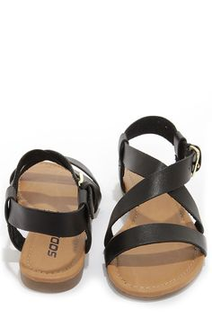 """Simple style doesn't have to be boring, especially when it gives you as many styling options as the Soda Borgo Black Ankle Strap Flat Sandals! Sturdy vegan leather straps create a basic toe band, plus crisscrossing ankle straps that adjust with a shiny gold buckle (and hidden elastic). 1/2"""" rubber heel. Lightly cushioned insole. Nonskid rubber sole. Available in whole and half sizes. Measurements are for a size 6. All vegan friendly, man made materials."""