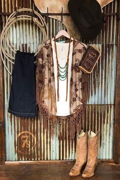 The Hoxie. Crushed velvet floral shawl. Gold and rust earth tones Sheer tulle with raised floral velvet pattern. Braided fringe trim. Angled hem. With lighter color underneath it gives it a variegated look in color. Completely change the look of this piece with a darker wine layer or shade of brown. Cowgirl style. Rodeo fashion. Women's Western Wear. Ranch style. Boho cowgirl. https://savannahsevens.com/collections/new-arrivals/products/the-hoxie