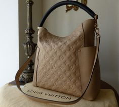 Louis Vuitton Bagatelle in Monogram Empreinte Dune > http://www.npnbags.co.uk/naughtipidginsnestshop/prod_3858448-Louis-Vuitton-Bagatelle-in-Monogram-Empreinte-Dune-NEW.html