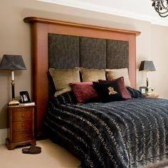 Hotel-style bedroom with upholstered headboard and velvet bedcovers