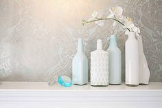 Paint the inside of bottles for a very chic look. This would also be a great idea for making lamp bases (using large vases instead).