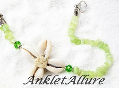 Beach Wedding Ankle Bracelet Cowrie Flower Beach Anklet Cowrie Shell Jewelry Cowrie Flower Ankle Bracelet Summer Sandals Beach Resort Caribbean Cruise Vacation Jewelry Shell Beach Body Jewelry Shell Foot Jewelry Beach Dress Beach Cover Peasant Skirt Gypsy Skirt Beach Skirt Beach Cover Shorts Capris Bridal Shower Gift Garter Ceremony Gift Bridesmaids Gift Cowrie Shell Flower Glass Green Crystals Glass Green Beads VERY STRONG !! Silver Toggle Quality Bead Wire approx 10.4 in ***LENGTH REQUESTS…